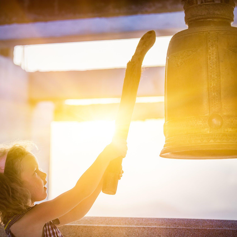Little girl hits the bell